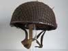 Rare British para helmet SAS marked, named an dated 1944 with combat netting.