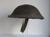 Mint, un-issued British helmet with netting marked and dated 1940